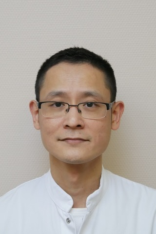 Dhr. drs. T. Cheung